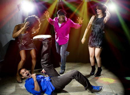 dancing club: Caucasian man falls but confidently plays cool in a dance club Stock Photo