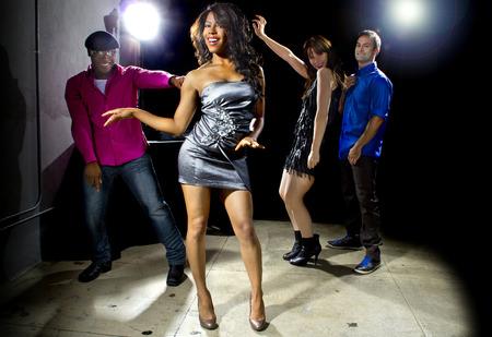 dancing club: cool people dancing in a nightclub or bar lounge