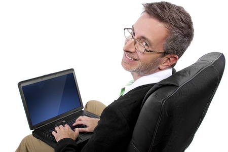 adult male working from home in a relaxing chair photo