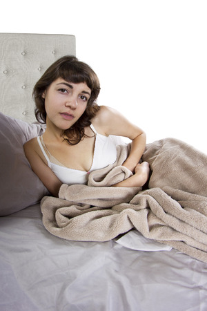 young adolescent female having abdominal cramps in the morning photo