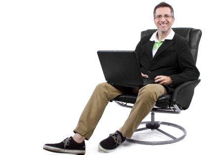 recliner: adult male working from home in a relaxing chair