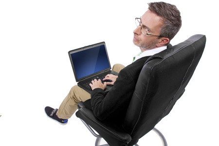 working from home: adult male working from home in a relaxing chair