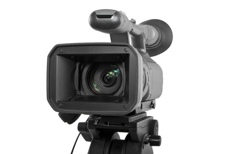 production camera on a tripod and isolated on white background