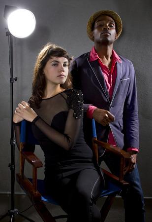 pompous: stylish actors posing on a concrete background with pompous expression Stock Photo