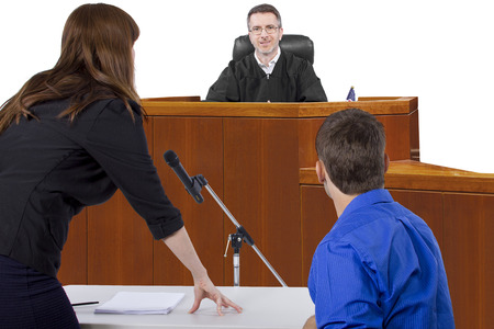 divorce court: defendant with lawyer speaking to a judge in the courtroom