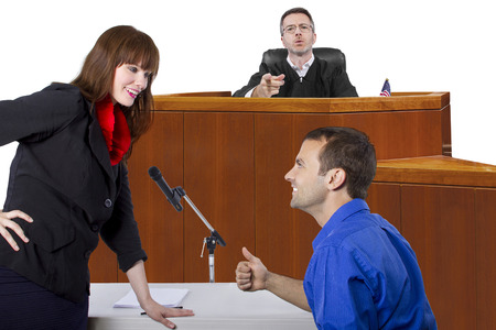defendant with lawyer speaking to a judge in the courtroom photo