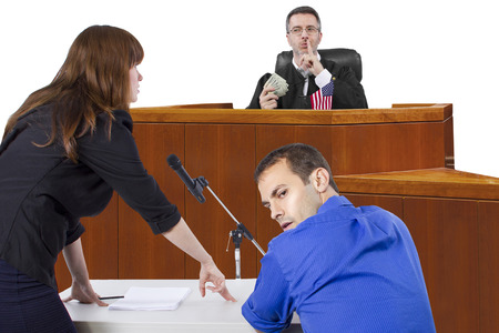 corrupt judge taking bribe in an unfair courtroom trial photo