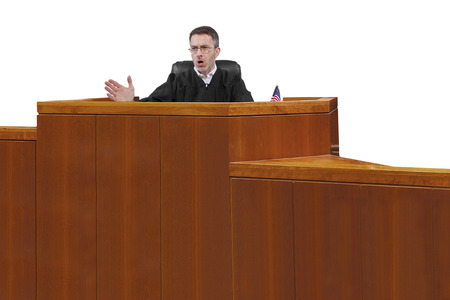 magistrate: middle aged caucasian american judge in a robe sitting