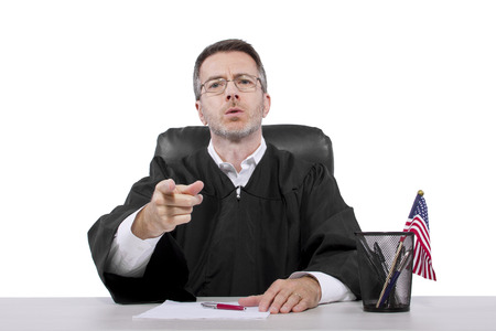 govt: middle aged caucasian american judge in a robe sitting