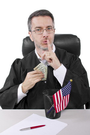 corrupt american judge taking money as a bribe or stealing photo