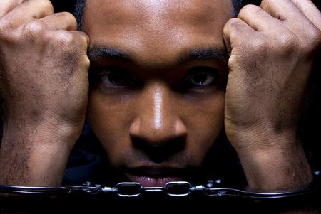 close up portrait of hand cuffed black man photo