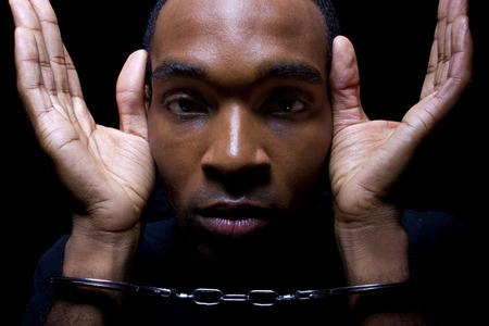 close up portrait of hand cuffed black man