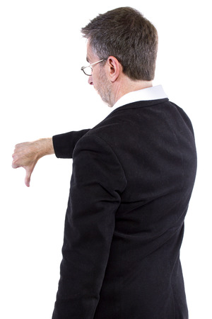 dissapointed: businessman with thumbs down gesture rear view Stock Photo