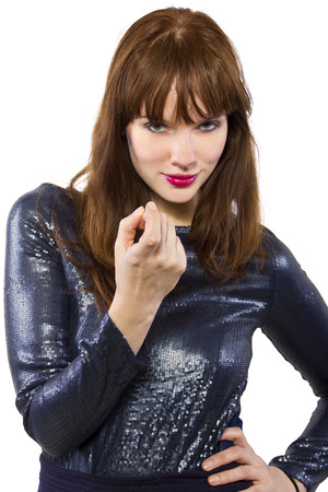 woman in shiny dress with summoning gesture