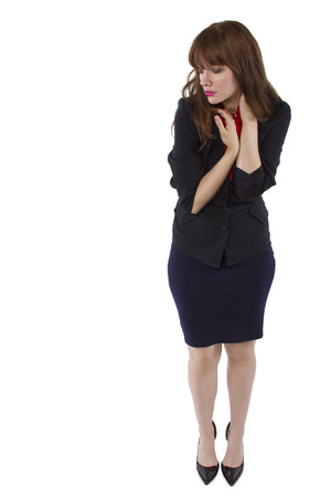 young pretty businesswoman with sneaky or cautious gesture Stock Photo