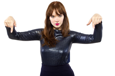 stylish female model in shiny dress with pointing gestures photo