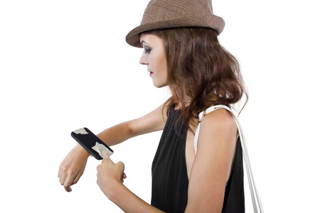 taped: cellphone taped into womans wrist as a DIY smart watch Stock Photo