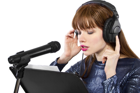 woman singing or reading a script for voice over Stock Photo