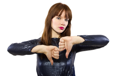 woman is shiny dress downvoting with thumbs down