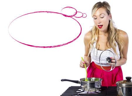 young cuacasian female making soup on a stove with white background photo