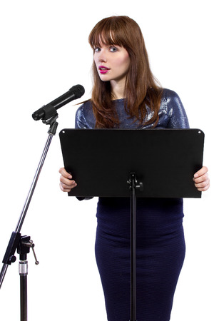 spokesperson: girl in shiny dress speaking on a microphone in a podium on white background