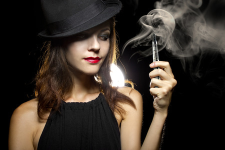 steam mouth: woman smoking or vaping an electronic cigarette to quit tobacco Stock Photo