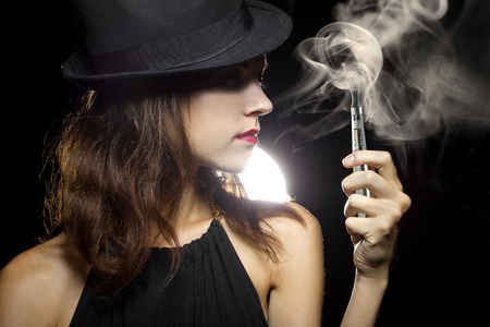 woman smoking or vaping an electronic cigarette to quit tobacco 스톡 콘텐츠