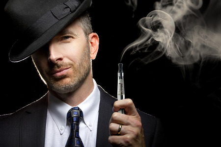 electronic background: male smoking a vapor cigarette as an alternative to tobacco