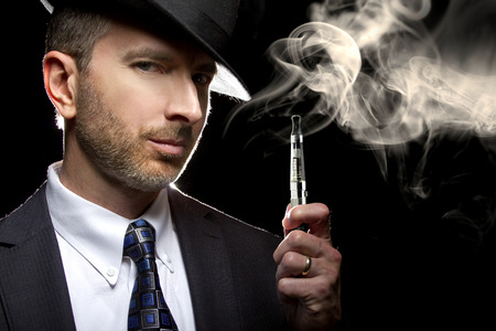 puffing: male smoking a vapor cigarette as an alternative to tobacco