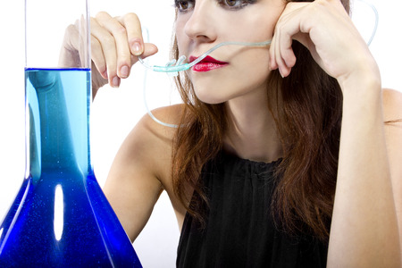 woman inhaling flavored oxygen with cannula and scented water Reklamní fotografie