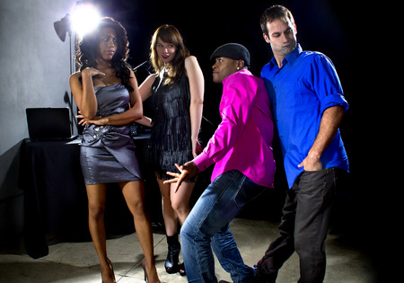 male and women rudely interrupted by a flirting pickup artist at a bar