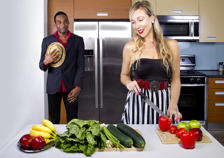 male coming home to wife cooking a surprise dinner