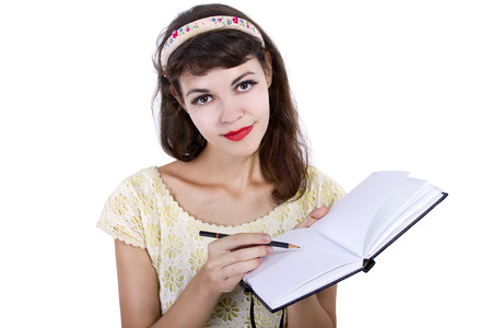 hand writing: young caucasian female with sketchbook and pencil on white background Stock Photo