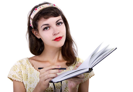 taking notes: young caucasian female with sketchbook and pencil on white background Stock Photo
