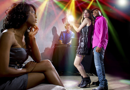 dancefloor: single black woman jealous of interracial couple on dancefloor Stock Photo