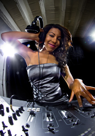young african american female dj playing music at a party 写真素材