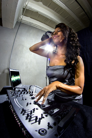 young african american female dj playing music at a party Stock Photo