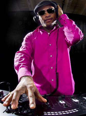 crossfader: Cool African American male DJ playing music at a party
