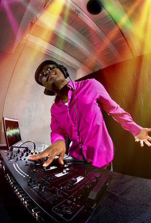 mc: Cool African American male DJ playing music at a party