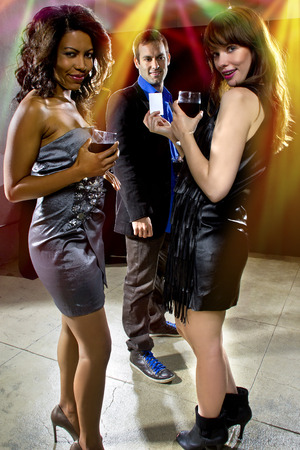 women seducing a man at a bar or nightclub photo