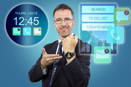 businessman showing custom smartwatch interface with apps