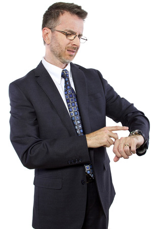 irate: caucasian businessman confused by new smart watch technology