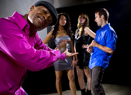 socially: laughing at a man getting rejected by girls at a nightclub Stock Photo