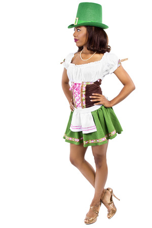 saint patty's: african american waitress dressed in st patricks day costume Stock Photo