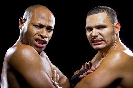the opponent: black boxer posing with latino opponent on a black background