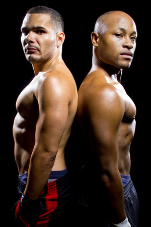 tegenstander: black boxer posing with latino opponent on a black background