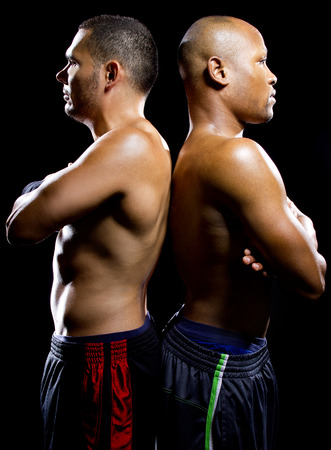 opponent: black boxer posing with latino opponent on a black background