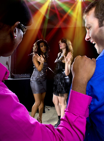 dancefloor: two pickup artists harrassing women at a nightclub