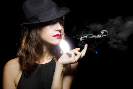 female vaping an electronic cigarette as a healthy alternative photo