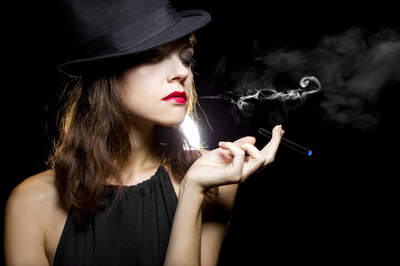 e cig: female vaping an electronic cigarette as a healthy alternative